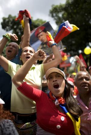 Supporters of Venezuela's President Hugo Chavez chant slogans during a march in Caracas, Venezuela, Sunday July 3, 2011.  Thousands of Venezuelans marched celebrating the country's bicentennial and also to show support for their president, who remains in Cuba recovering from surgery. (AP Photo/Ariana Cubillos))