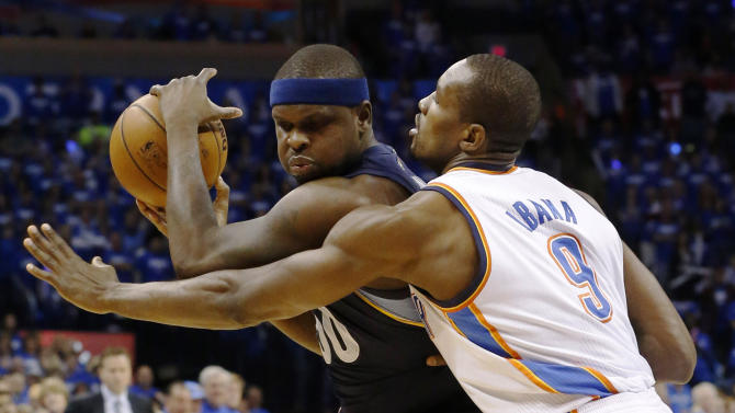 Memphis Grizzlies forward Zach Randolph (50) is guarded by Oklahoma City Thunder power forward Serge Ibaka (9) during the first quarter of Game 1 of their Western Conference Semifinals NBA basketball playoff series in Oklahoma City, Sunday, May 5, 2013. (AP Photo/Sue Ogrocki)