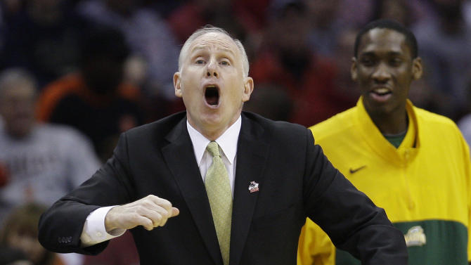 FILE - This March 20, 2011, file photo shows George Mason coach Jim Larranaga yelling to his players in the first half of an East regional NCAA college basketball tournament third-round game against Ohio State,  in Cleveland. George Mason's athletic director says Larranaga is leaving to become the men's basketball coach at the University of Miami. Tom O'Connor tells The Associated Press that Larranaga called Friday morning, April 22, 2011,  to say that he has accepted the job at the Atlantic Coast Conference school. (AP Photo/Tony Dejak, File)