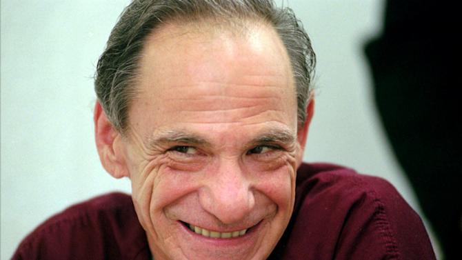 "FILE - In this May 9, 1997 file photo, Henry Hill smiles during an interview at the Essex County Jail in Newark, N.J. Hill, whose life as a mobster and FBI informant was the basis for the Martin Scorcese film ""Goodfellas,"" has died. Hill's girlfriend Lisa Caserta says he died in a Los Angeles hospital after a long illness. He was 69. (AP Photo/Mike Derer)"