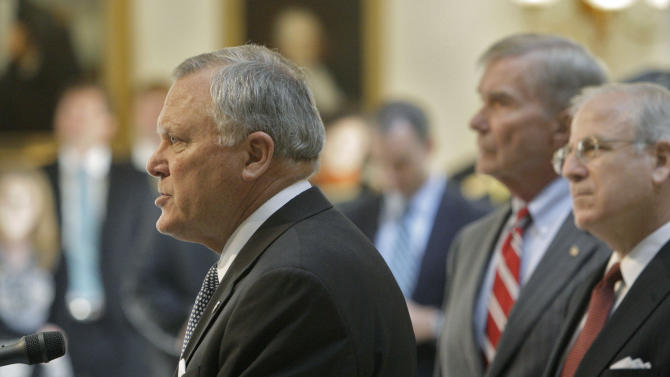 Gov. Nathan Deal  speaks at a  news conference, as former Attorney General Mike Bowers and Dekalb County DA Bob Wilson, right, listen,  on Tuesday, July 5, 2011 in Atlanta.  A probe has found that more than 78 percent of Atlanta schools examined by state investigators engaged in cheating on standardized tests.  Deal said 44 of the 56 schools investigated took part in cheating. Investigators also found that 38 principals were wither responsible for the cheating or were directly involved in it. And they determined that 178 teachers and principals cheated. Of those, 82 confessed to the misconduct.  (AP Photo/Atlanta Journal & Constitution, Bob Andres)