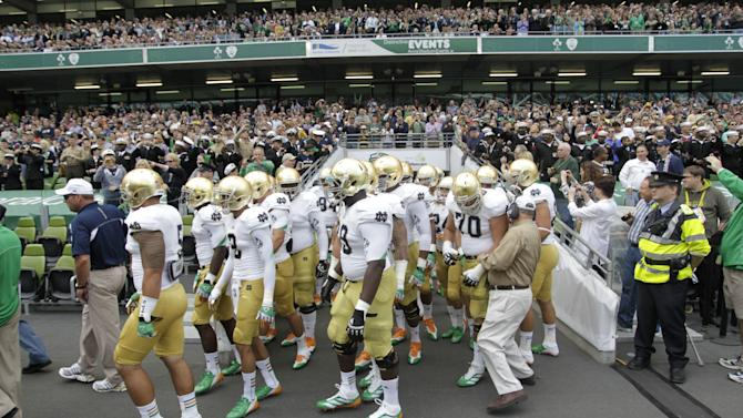 Notre Dame make their way onto the field before an NCAA college football game against Navy in Dublin, Ireland, Saturday, Sept. 1, 2012.  (AP Photo/Peter Morrison)