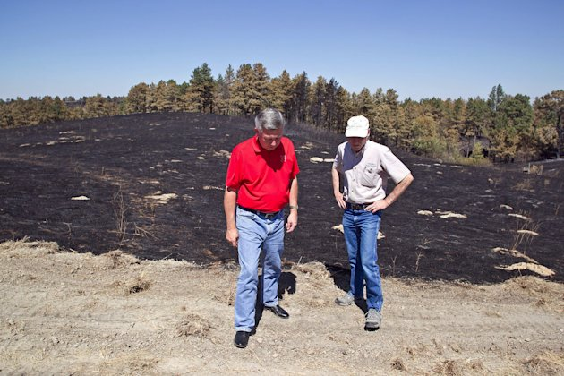Nebraska Gov. Heineman, left, talks with Scott Josiah, state forester and director of Nebraska Forest Service, as they inspect fire damage at Chadron State Park, Sunday, Sept. 2, 2012, near Chadron, Neb. Officials estimated Sunday that the fires have now burned roughly 273 square miles, including at least 27,000 acres in South Dakota. That&#39;s up from roughly 93 square miles on Saturday and more than twice the size of Omaha. (AP Photo/Omaha World-Herald, Jeff Beiermann, Pool)