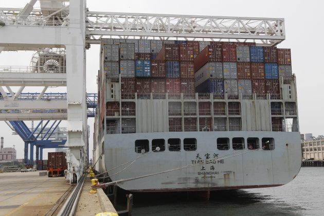 In this Friday, July 13, 2012, photo, a container ship from China is docked at Massport's Conley Terminal in the port of Boston. The U.S. trade deficit widened in August 2012 as exports fell to the lowest level in six months, a worrisome sign that a slowing global economy is cutting into demand for U.S. goods (AP Photo/Stephan Savoia)