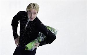 Russia's Evgeni Plushenko holds a bouquet of flowers after his performance in the men's short program at the European Figure Skating Championships in Zagreb