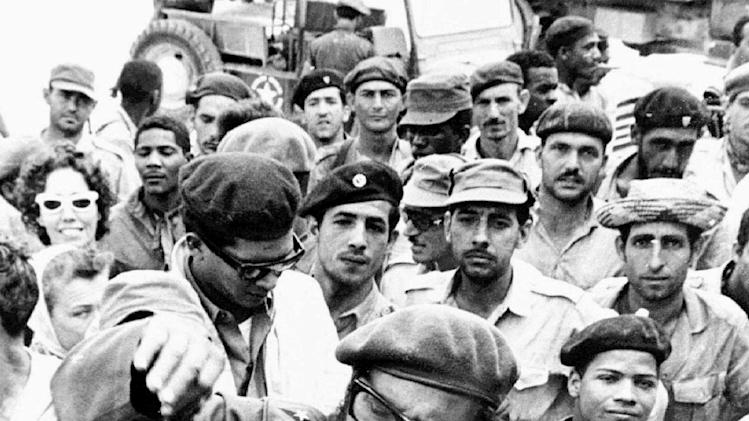 This April 1961 file photo shows Fidel Castro, center, with members of the Revolutionary Armed Forces at his base of operations at the Australia Sugar Refinery in Jaguey, near Playa Giron, during the Bay of Pigs invasion in April 1961. (AP Photo/Str)