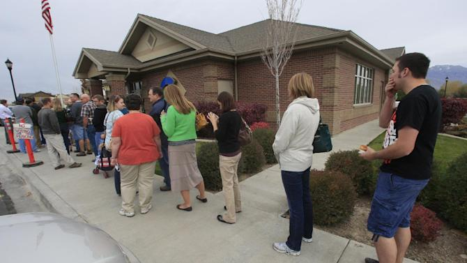People wait in line to vote at a polling place Thursday, Nov. 1, 2012, Saratoga Springs, Utah, days ahead of the Nov. 6 election. (AP Photo/Rick Bowmer)