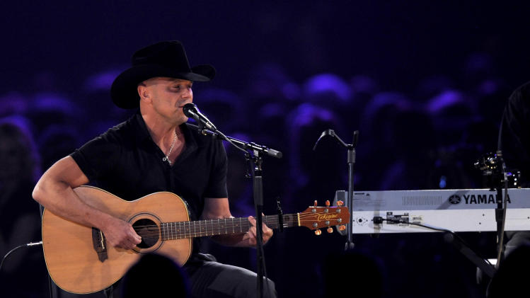 "Kenny Chesney performs ""One Step Up"" at the MusiCares Person of the Year tribute honoring Bruce Springsteen at the Los Angeles Convention Center on Friday Feb. 8, 2013, in Los Angeles. (Photo by Chris Pizzello/Invision/AP)"
