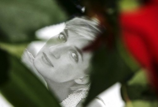 File photo of a card with a portrait of Diana, the late Princess of Wales, amongst red roses outside Kensington Palace in London. Princess Diana's death 15 years ago this week made the British monarchy more attuned to their own image and changed forever the way the young royals behave to their subjects, royal watchers say.