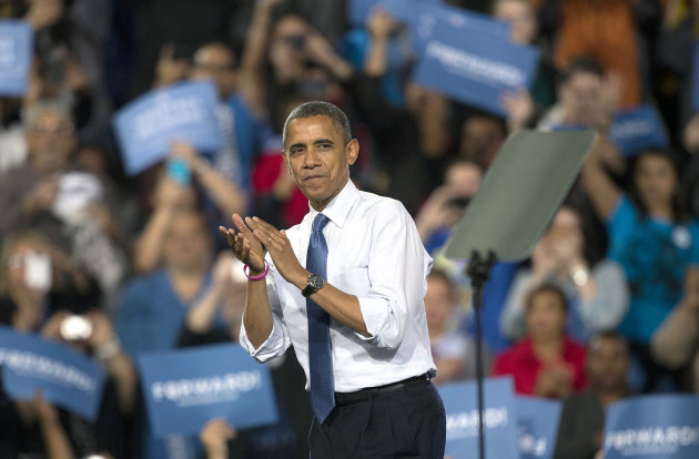 President Barack Obama applauds with the crowd after speaking at a campaign rally, Wednesday, Oct. 24, 2012, in Las Vegas. The president is on a two-day tour of key battleground states that included stops in Iowa and Colorado on Wednesday and was scheduled to head to Florida, Virginia and Ohio on Thursday. (AP Photo/Julie Jacobson)