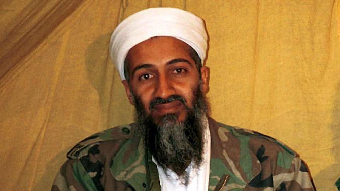 """FILE - This undated file photo shows al Qaida leader Osama bin Laden in Afghanistan. Osama bin Laden's spokesman and son-in-law has been captured by U.S. intelligence officials, officials said Thursday, in what a senior congressman called a """"very significant victory"""" in the ongoing fight against al-Qaida. A Jordanian security official confirmed that al-Ghaith was handed over last week to U.S. law enforcement officials under both nations' extradition treaty. He declined to disclose other details and spoke on condition of anonymity because of the sensitivity of the matter.  (AP Photo)"""