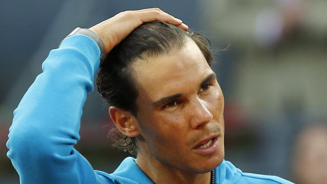 FILE - In this May 10, 2015, file photo, Rafael Nadal, of Spain, makes a speech after losing to Andy Murray of Britain during the men's final at the Madrid Open Tennis tournament in Madrid, Spain. For years and years _ a full decade, in fact _ Nadal has dominated the French Open the way no one has ever dominated a Grand Slam tennis tournament. Despite the way he's ruled Roland Garros, Novak Djokovic is considered the man to beat, (AP Photo/Paul White, File)