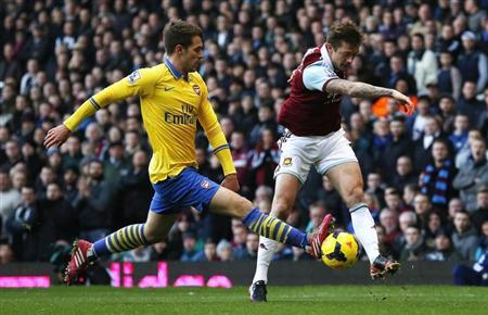 Arsenal's Ramsey challenges West Ham United's McCartney during their English Premier League soccer match in London