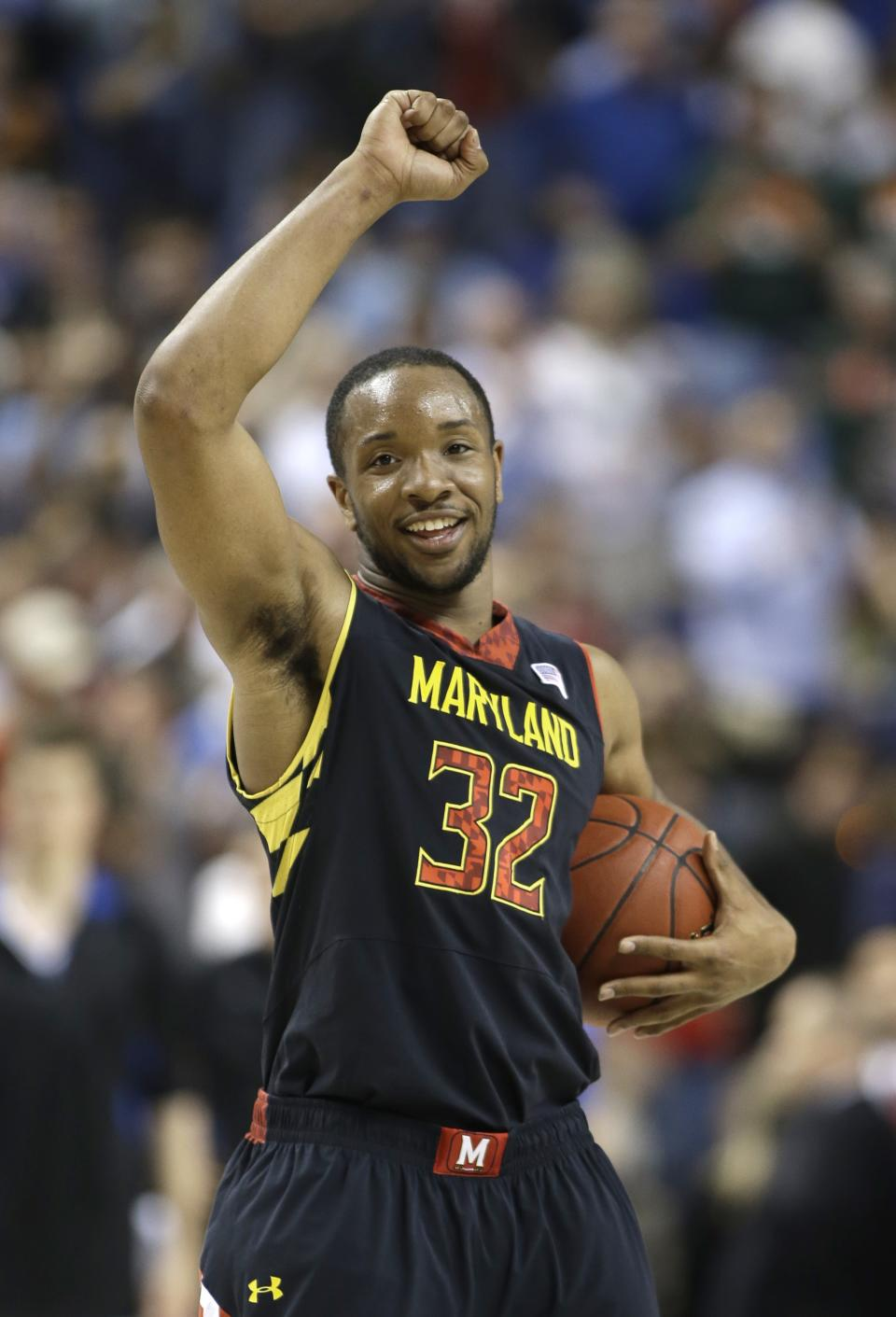 Maryland's Dez Wells smiles in the final seconds of an NCAA college basketball game against Duke at the Atlantic Coast Conference men's tournament in Greensboro, N.C., Friday, March 15, 2013. Maryland won 83-74. (AP Photo/Bob Leverone)