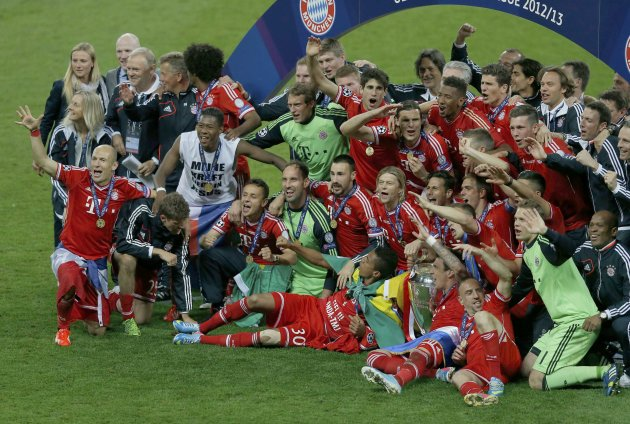 Bayern Munich players celebrate with the trophy after defeating Borussia Dortmund in their Champions League Final soccer match at Wembley Stadium in London