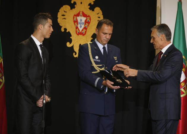 Portugal's soccer team captain Ronaldo is decorated with the Ordem do Infante Dom Henrique by Portugal's President Cavaco Silva in Lisbon