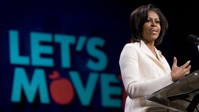 """FILE - In this Feb. 9, 2011 file photo, First Lady Michelle Obama talks about her """"Lets Move"""" campaign at North Point Community Church in Alpharetta, Ga. Encouraged by Michelle Obama's campaign to reduce childhood obesity, the company that owns the Olive Garden, Red Lobster and four other popular restaurant chains is pledging to cut the calories and sodium in its meals and overhaul its kids' fare. (AP Photo/John Amis, File)"""
