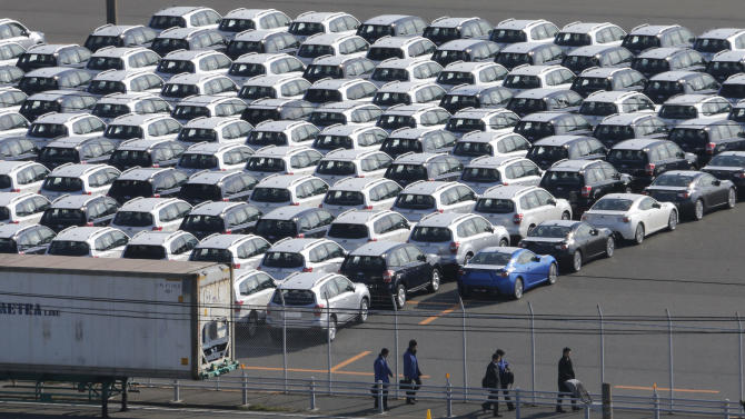 Cars for export park at a port in Kawasaki, west of Tokyo, Thursday, Dec. 20, 2012. Japan is reporting its fifth straight month of trade deficits for November, marking a lengthy span of lagging exports that highlights a struggling economy. The Finance Ministry released data Wednesday, Dec. 19, showing the trade deficit soared nearly 38 percent last month compared to November the previous year. (AP Photo/Koji Sasahara)
