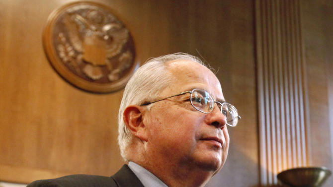 FILE - In this Oct. 13, 2011, file photo, Larry Echo Hawk, Assistant Secretary of Indian Affairs Larry Echo Hawk, left, appears on Capitol Hill in Washington before a Senate Indian Affairs Committee hearing. Echo Hawk is resigning to accept a full-time leadership position with The Church of Jesus Christ of Latter-day Saints. The announcement from the church that Echo Hawk, assistant secretary of the Interior for Indian Affairs, is being appointed to the Quorum of the Seventy, which is the Mormon Church's third-highest governing body, came Saturday, March 31, 2012, during its semi-annual general conference in Salt Lake City. (AP Photo/Jacquelyn Martin, File)