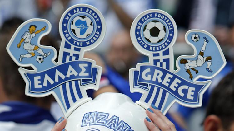 A Greek fan smiles before the Euro 2012 soccer championship Group A match between Greece and Czech Republic in Wroclaw, Poland, Tuesday, June 12, 2012. (AP Photo/Thanassis Stavrakis)