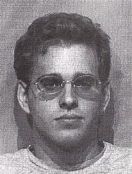 "Kyle Prall, founder of bustedmugshots.com, is seen in an undated police booking photo from the McLean County Sheriff's Department. Prall's website collects publicly accessible police booking photos and displays them. People who find their mug shots displayed on Prall's website, or others like it, can have the pictures removed for what they refer to as a ""nominal fee."" REUTERS/McLean County Sheriff's Office/Handout"