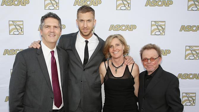 ASCAP EVP of Membership Randy Grimmett, songwriter/producer Calvin Harris, ASCAP Vice President, Membership - Pop/Rock Sue Drew, and ASCAP President and Chairman of the Board Paul Williams arrive at the 30th Annual ASCAP Pop Music Awards, on Wednesday, April 16, 2013, at Loews Hollywood Hotel in Hollywood, California. (Photo by Brian Dowling/Invision for ASCAP/AP Images)