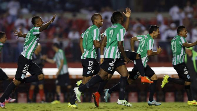 Players of Colombia's Atletico Nacional celebrate after beating Brazil's Sao Paulo during their Copa Sudamericana semi-final soccer match in Sao Paulo