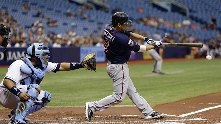 Minnesota Twins' Kurt Suzuki, right, lines a two-run single off Tampa Bay Rays starting pitcher Erik Bedard during first inning of a baseball game Thursday, April 24, 2014, in St. Petersburg, Fla. Twins' Brian Dozier and Joe Mauer scored on the hit. Catching for the Rays is Jose Molina. (AP Photo/Chris O'Meara)