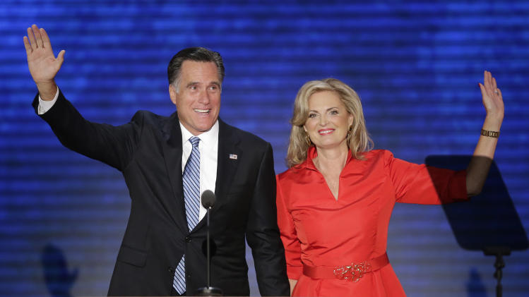 Ann Romney, waves with her husband Republican presidential nominee Mitt Romney during the Republican National Convention in Tampa, Fla., on Tuesday, Aug. 28, 2012. (AP Photo/J. Scott Applewhite)
