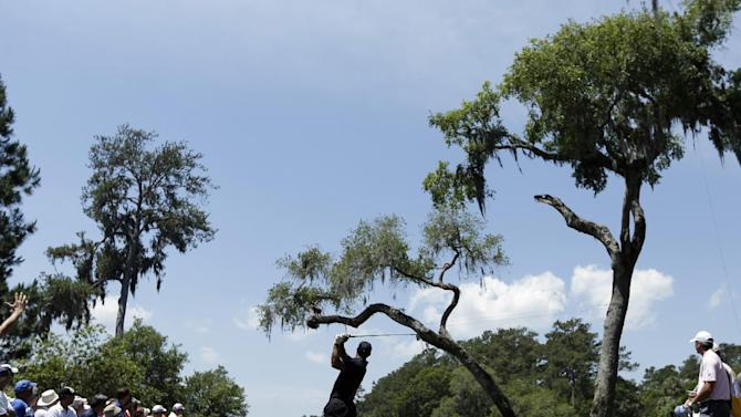 Tiger Woods hits from the sixth tee during the second round of The Players championship golf tournament at TPC Sawgrass, Friday, May 10, 2013 in Ponte Vedra Beach, Fla. (AP Photo/Chris O'Meara)