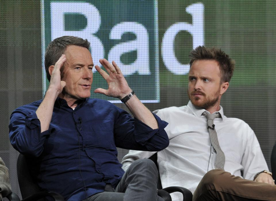 "Bryan Cranston, left, and Aaron Paul, cast members in ""Breaking Bad,"" take part in a panel discussion during AMC's Summer 2013 TCA press tour at The Beverly Hilton Hotel on Friday, July 26, 2013, in Beverly Hills, Calif. (Photo by Chris Pizzello/Invision/AP)"