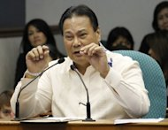Supreme Court Chief Justice Renato Corona attends his impeachment trial at the Senate in Manila, on May 25. Philippine senators have found Corona guilty of corruption, paving the way for him to be sacked in the biggest win of President Benigno Aquino's anti-graft crusade