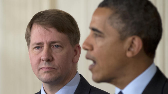 Richard Cordray stands left as President Barack Obama announces in the State Dining Room of the White House in Washington, Thursday, Jan. 24, 2013, that he will re-nominate Cordray to lead the Consumer Financial Protection Bureau, a role that he has held for the last year under a recess appointment, and nominate Mary Joe White to lead the Security and Exchange Commission (SEC).  (AP Photo/Carolyn Kaster)