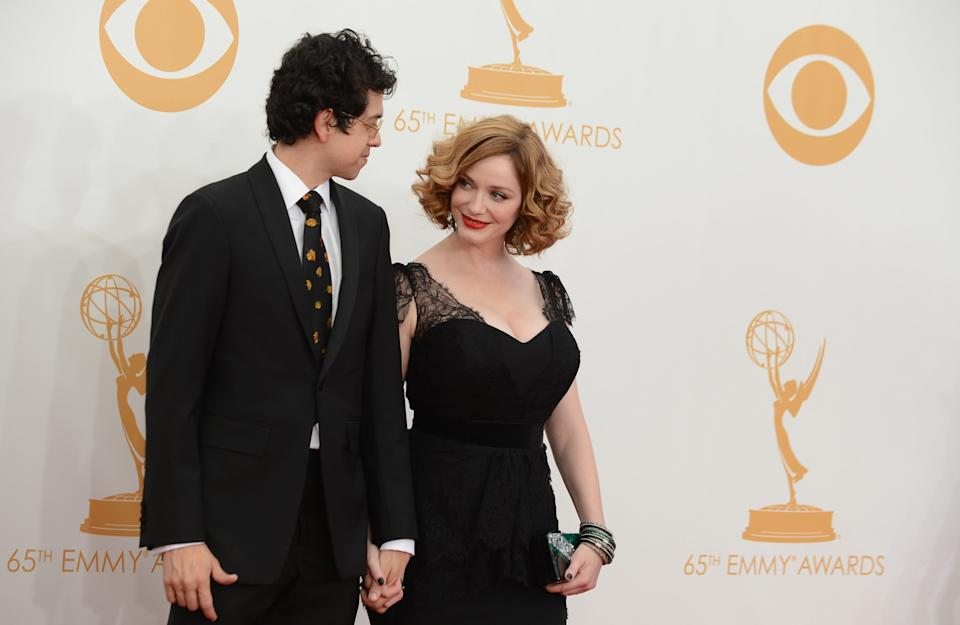 Geoffrey Arend, left, and Christina Hendricks arrive at the 65th Primetime Emmy Awards at Nokia Theatre on Sunday Sept. 22, 2013, in Los Angeles. (Photo by Jordan Strauss/Invision/AP)