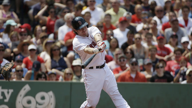 Boston Red Sox's Ryan Hanigan hits an RBI-single off a pitch by Houston Astros starting pitcher Lance McCullers in the second inning of a baseball game at Fenway Park, Sunday, July 5, 2015, in Boston. (AP Photo/Steven Senne)