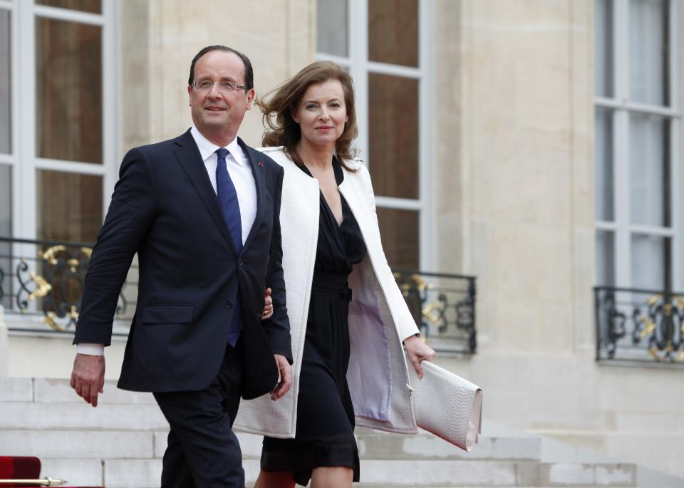 New President Francois Hollande and his companion Valerie Trierwieler leave the Elysee Palace, Tuesday, May 15, 2012 in Paris.  (AP Photo/Thibault Camus)