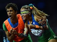 Brazil&#39;s Terezinha Guilhermina (right) and her guide Guilherme Soares de Santana celebrate after winning the women&#39;s 100m T11 final at the London 2012 Paralympic Games on September 5. Spurred on by Icelandic songstress Bjork, crowds at the London 2012 Paralympics are keeping a lid on their excitement for blind sports that need to be played in silence