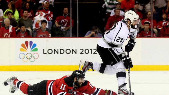 Jarret Stoll #28 Of The Los Angeles Kings Handles The Puck As Stephen Gionta #11 Of The New Jersey Devils Hits The  Getty Images