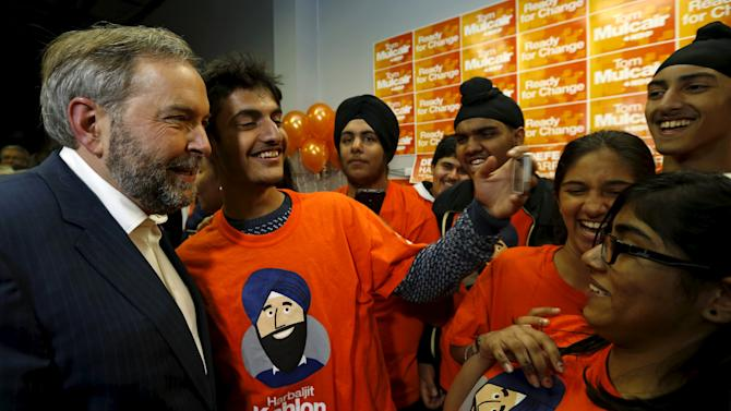 Canada's New Democratic Party (NDP) leader Thomas Mulcair has his picture taken with supporters at a campaign event in Brampton
