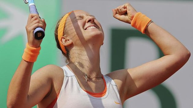Victoria Azarenka of Belarus celebrates defeating Maria Kirilenko of Russia in their women's singles quarter-final match during the French Open tennis tournament at the Roland Garros stadium in Paris June 5, 2013. REUTERS