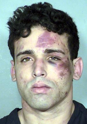 This image provided by the Las Vegas Metropolitan Police Department shows a booking photo of a man identified only as John Doe. Las Vegas police say the man apparently provided a fake name following his arrest Tuesday March 18, 2014, on attempted murder, armed robbery and burglary with a weapon charge. Police say the man looted a dressing room and fired one shot with a handgun before he was tackled Tuesday, by members of the Thunder From Down Under male revue as he tried to flee the Excalibur Hotel. (AP Photo/Las Vegas Metropolitan Police Department)
