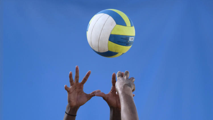 Puerto Rico's Yamileska Yantin, left, reaches for the ball during a women's beach volleyball match against Argentina at the Pan American Games in Puerto Vallarta, Mexico, Tuesday Oct. 18, 2011. (AP Photo/Ariana Cubillos)