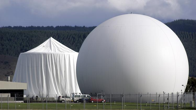 This April 30 2008 photo shows a satellite communications dome at Waihopai satellite communications interception station near Blenheim, New Zealand. Waihopai satellite communications is part of a surveillance spying alliance known as Five Eyes that groups together five English-speaking democracies - the U.S., Britain, Canada, Australia and New Zealand - collaboration that began during World War II when the allies were trying to crack German and Japanese naval codes and has endured for more than 70 years. At left is a damaged satellite communications dome covered with a tent. (AP Photo/New Zealand Herald, Tim Cuff) NEW ZEALAND OUT, AUSTRALIA OUT