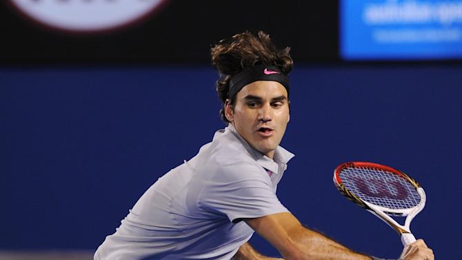 Switzerland's Roger Federer hits a backhand return to Canada's Milos Raonic during their fourth round match at the Australian Open tennis championship in Melbourne, Australia, Monday, Jan. 21, 2013. (AP Photo/Andrew Brownbill)