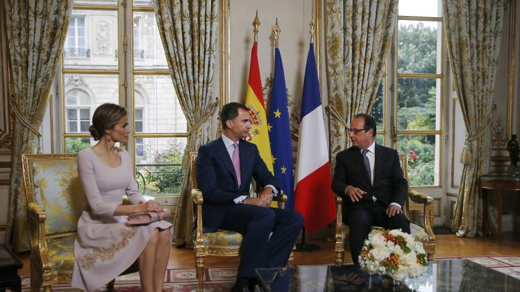 French President Francois Hollande attends a meeting with Spain's King Felipe VI and Queen Letizia prior to a lunch at the Elysee Palace in Paris