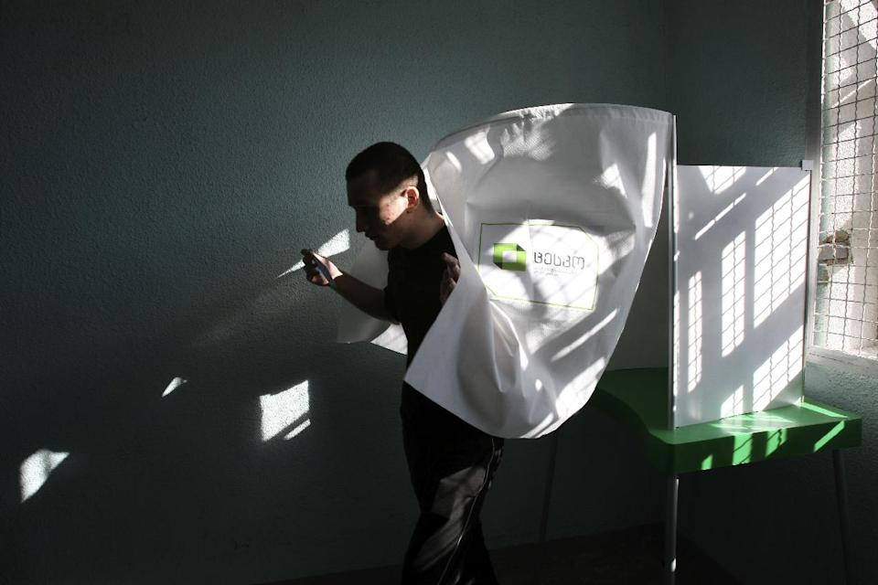 A prisoner leaves a voting booth at a polling station in prison, Tbilisi, Georgia, Monday, Oct. 1, 2012.  Voters in Georgia are voting in parliamentary elections in a heated election Monday that will decide the future of Saakashvili's government. (AP Photo/Shakh Aivazov)