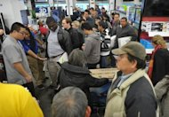 <p>Shoppers inside a Best Buy store in Rockville, Maryland which began its Black Friday sale at midnight on November 22. In the hopes of snagging everything from electronics to clothes and other products at discount prices, some competitive shoppers lost their cool as they tussled over items or staked out their spots in line.</p>