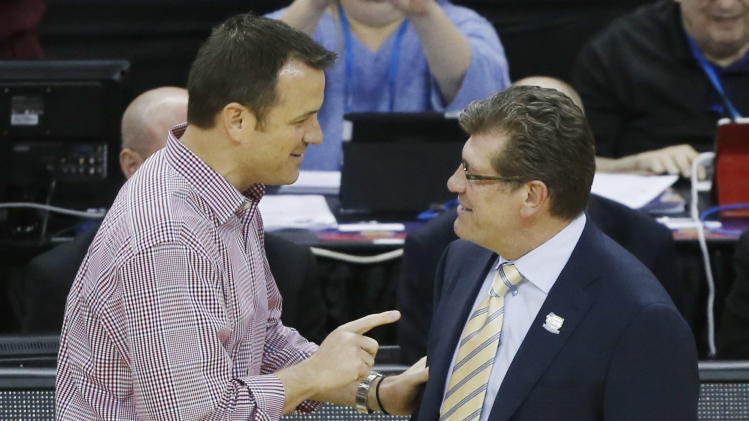 Louisville head coach Jeff Walz, left, and Connecticut head coach Geno Auriemma meet before the national championship game of the women's Final Four of the NCAA college basketball tournament, Tuesday, April 9, 2013, in New Orleans. (AP Photo/Bill Haber)