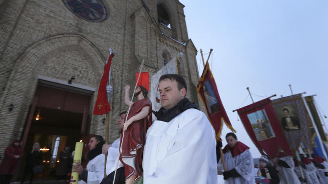 Belarusian Roman Catholics take part in a procession around a church as they celebrate Easter in small town Rakov, some 45 kilometers (28 miles) northwest of Minsk, Belarus, Sunday, March 31, 2013. (AP Photo/Sergei Grits)