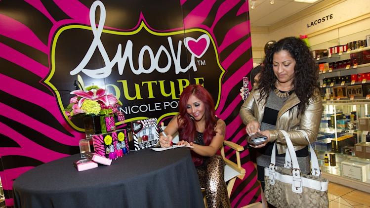 "Nicole ""Snooki"" Polizzi signs autographs for fans at Perfumania for the release of her second fragrance, ""Snooki Couture"" on Wednesday, January 9, 2013, in Las Vegas, NV (Photo by Al Powers/Powers Imagery/Invision/AP)"